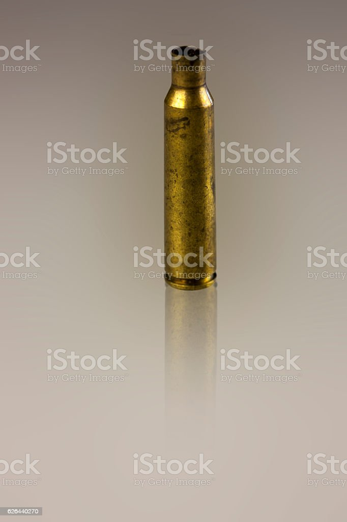 Rifle bullet case stock photo