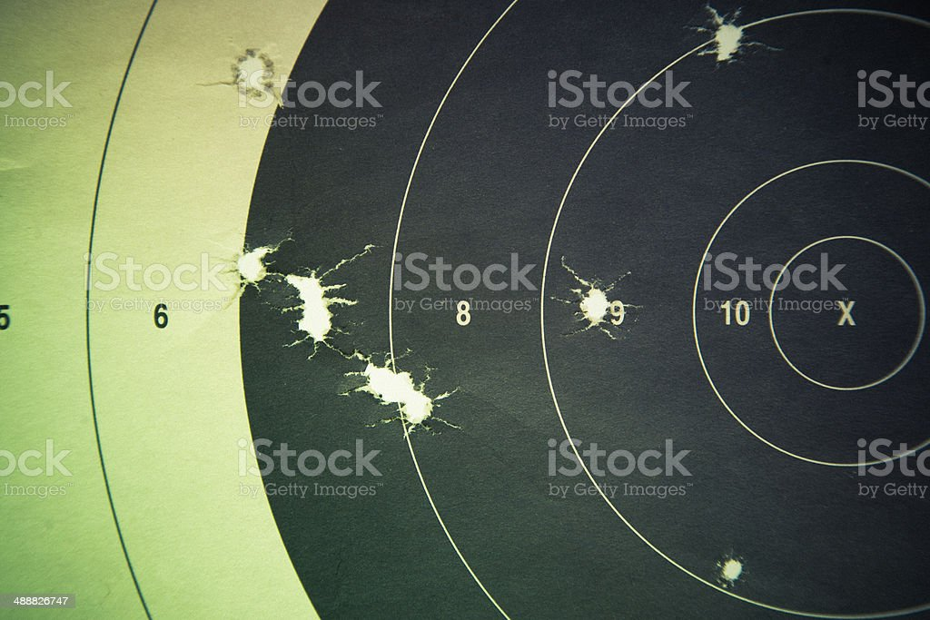 Rifle Handgun Target with bullet holes stock photo