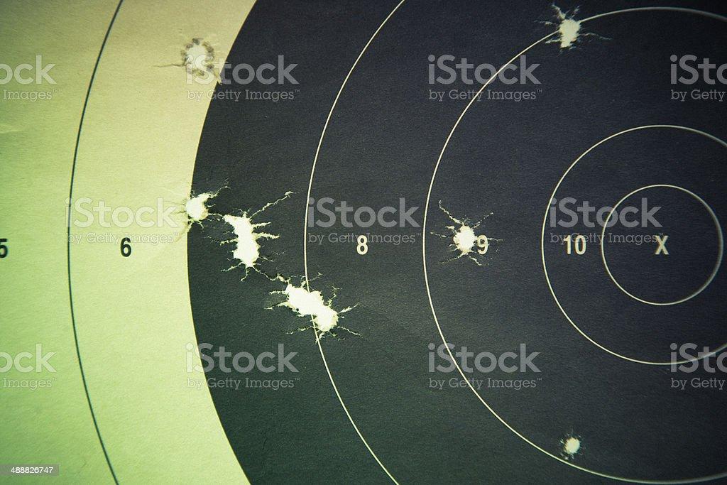 Rifle Handgun Target with bullet holes stock photo
