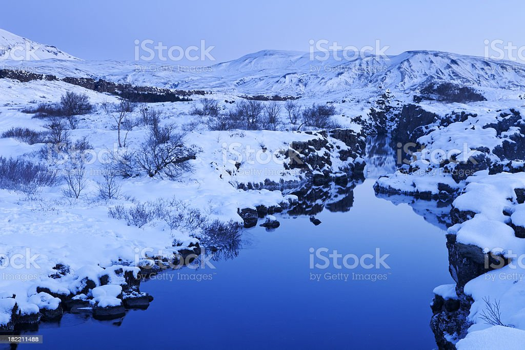 Rift in Thingvellir National Park, Iceland in winter at dawn stock photo