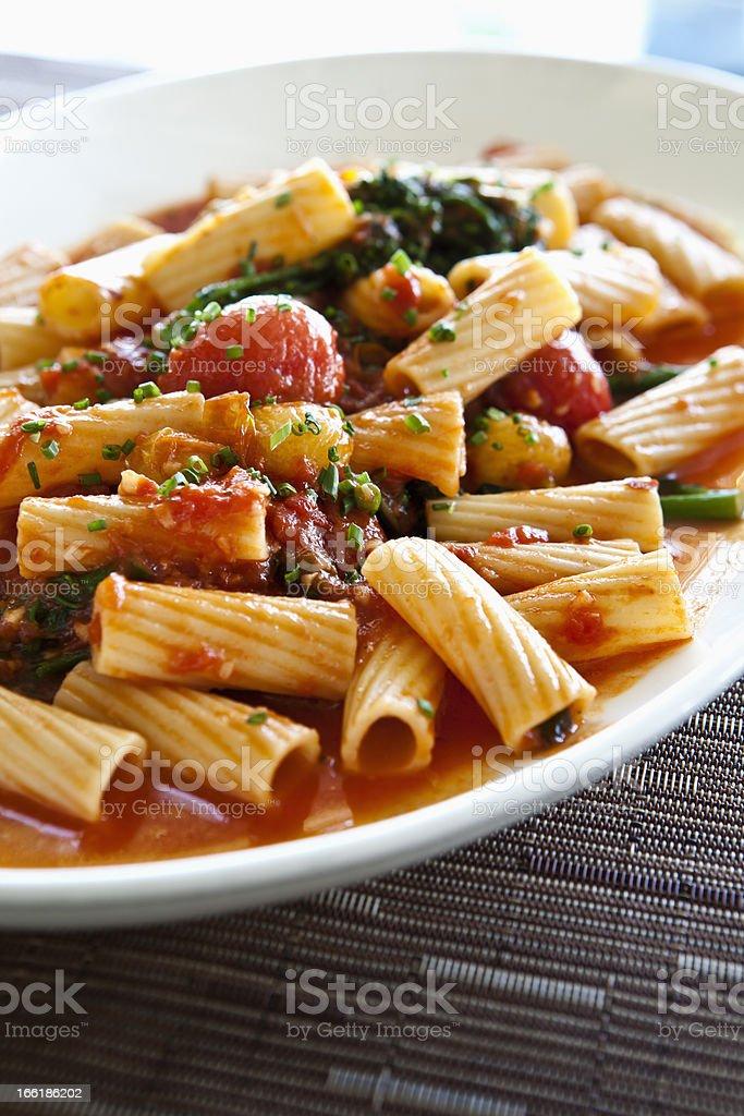Rigatoni pasta in tomato sause stock photo