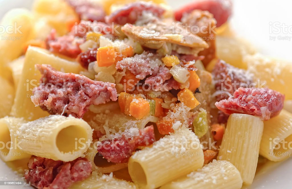 Rigatoni pasta with sausages and mushrooms stock photo