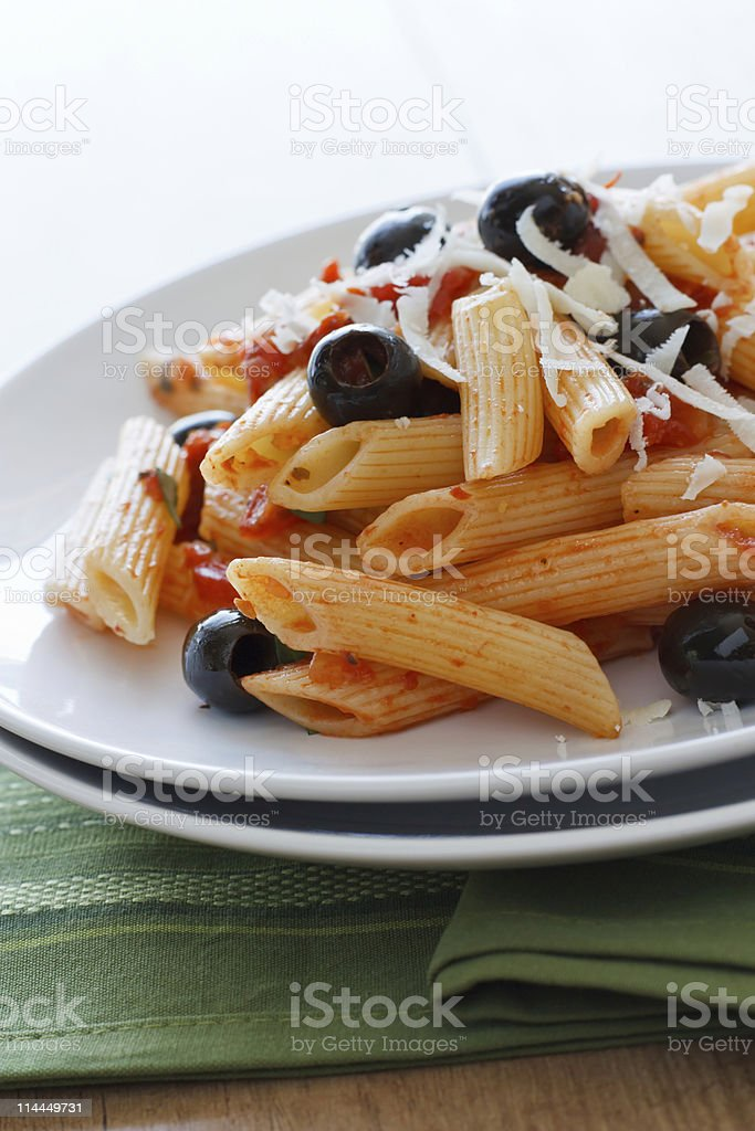 Rigatoni with Olives and Tomatoes royalty-free stock photo