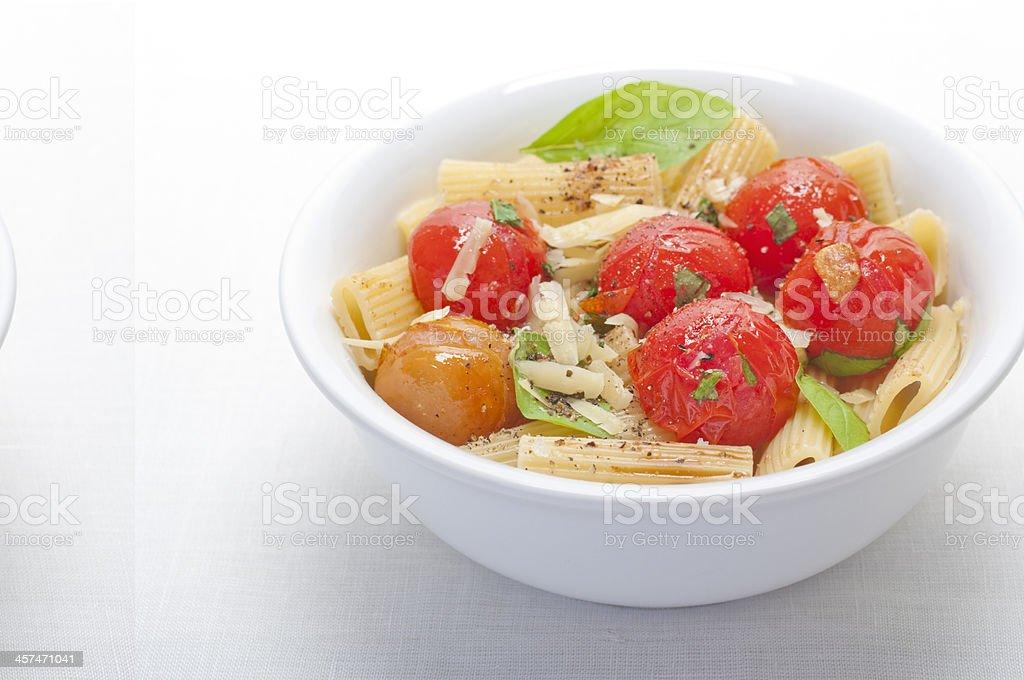 Rigatoni with tomato and basil royalty-free stock photo
