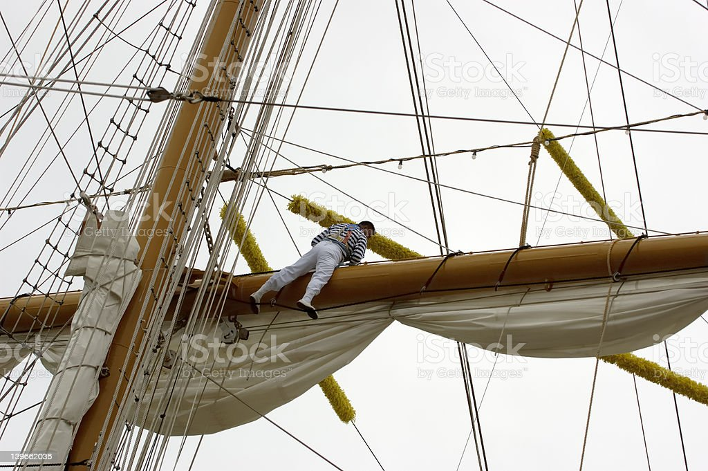 Rigger working on Tall Ship royalty-free stock photo