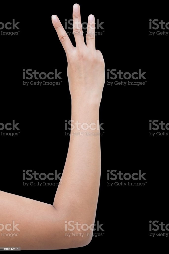 right back hand a woman show the third, number three sign. isolated on black background stock photo