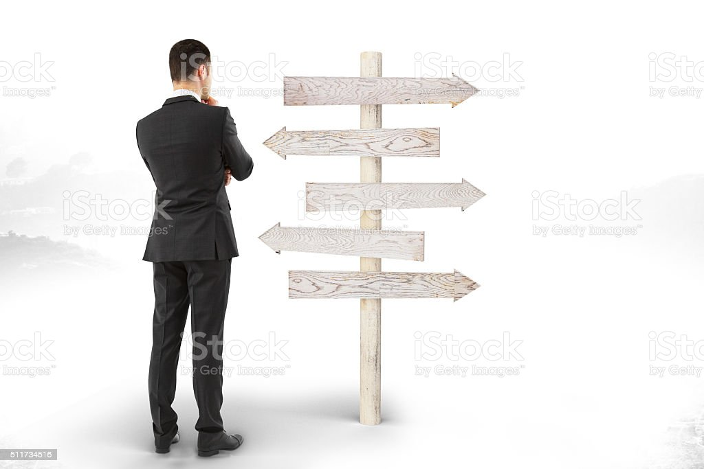 Right decision concept with businessman looks at the pointer wit stock photo