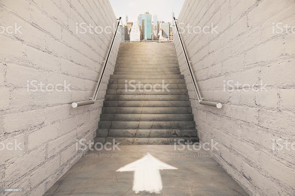 Right direction on staircase concept stock photo