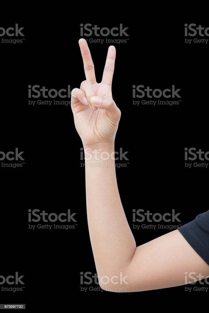 right hand a woman show the second, number two, fight, encouragement sign. isolated on black background stock photo