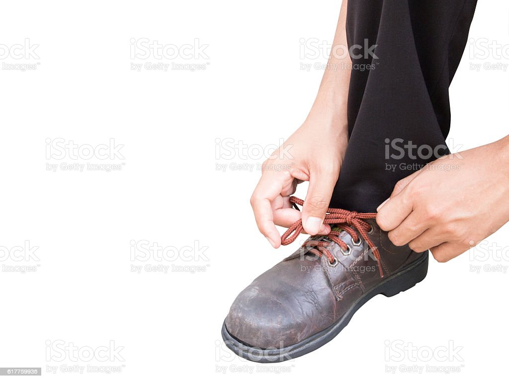 right hand of a business man tying shoes with isolated stock photo