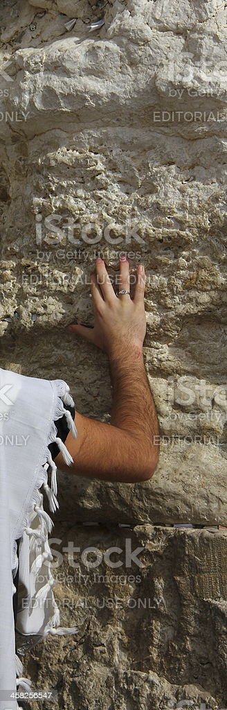 Right hand of praying man on the Western wall stone royalty-free stock photo