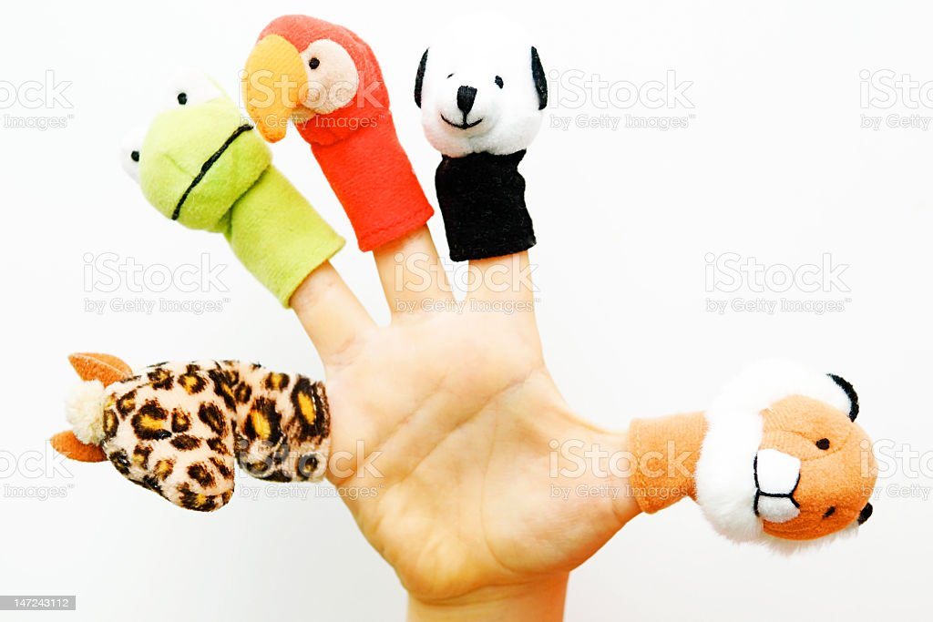 Right hand wearing five different finger puppets stock photo