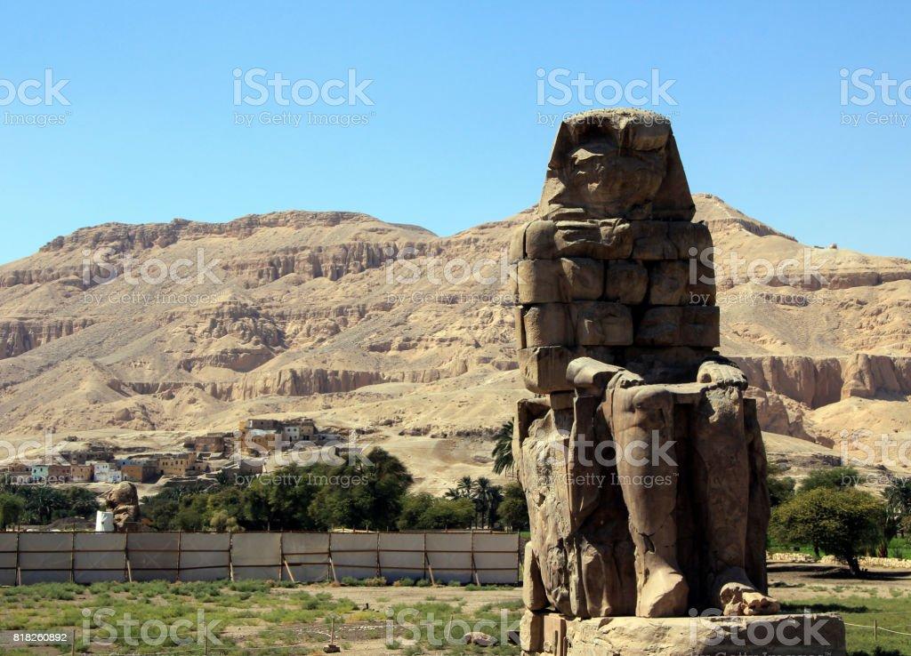 Right massive stone statue of the Pharaoh Amenhotep III. stock photo