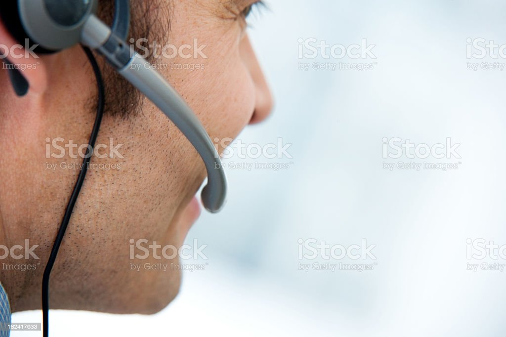 Right side profile of man in call center with headset stock photo