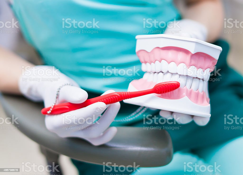 Right technique of cleaning teeth performed by professional dentist stock photo