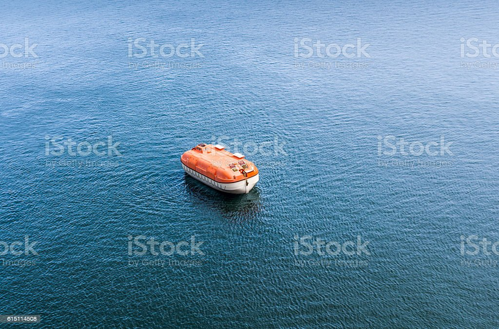 Rigid lifeboat during rescue excesizes alone in the sea stock photo