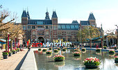 Rijksmuseum entrance and tulips  in spring