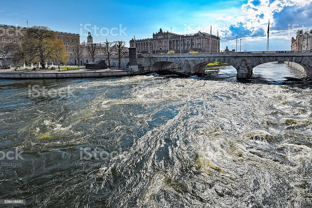 Riksdag Parliament Building and Norrbro Bridge In Stockholm stock photo