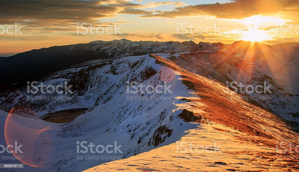 Rila Mountains ridge sunrise stock photo
