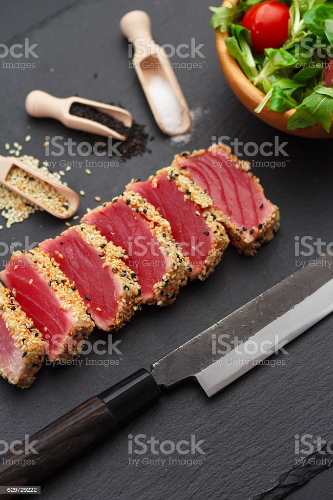 rilled tuna fillet with sesame on a stone plate. stock photo