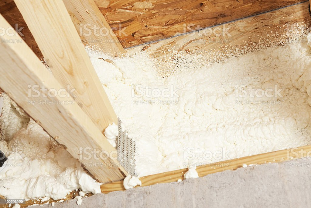 Rim Joist Insulated with Expandable Spray Foam Insulation stock photo