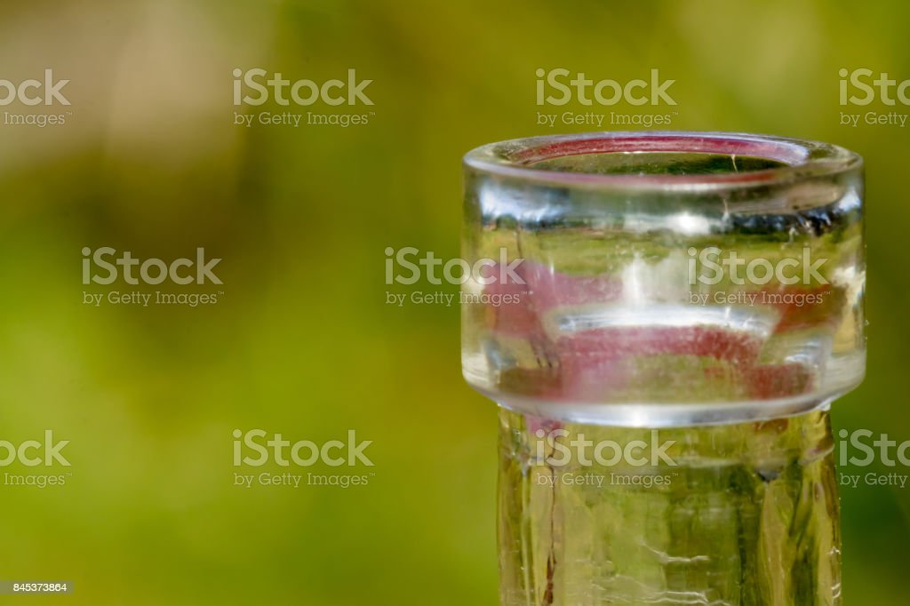 rim of the mouth of a small narrow necked clear glass bottle stock photo