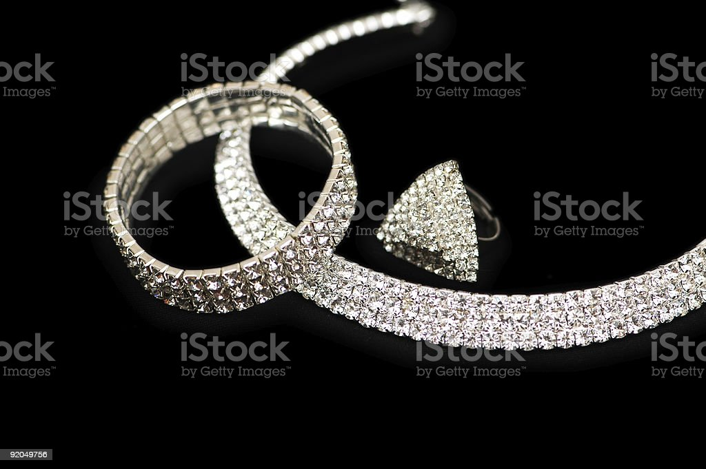 Ring, bracelet and necklace  isolated on black royalty-free stock photo