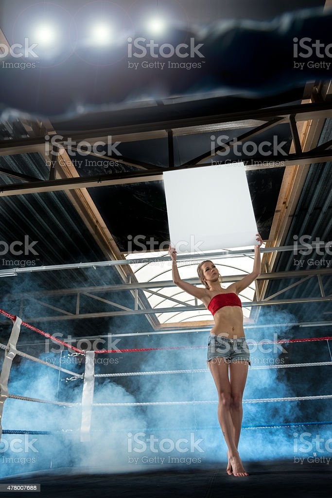 Ring Girl Announcing Start of Round at box match stock photo