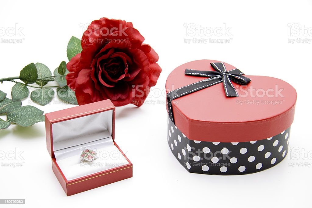 Ring in the case with heart and rose stock photo