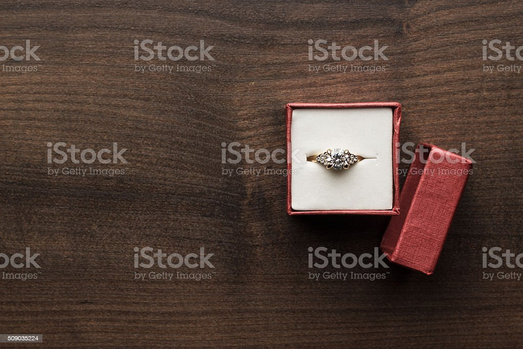 ring in the red box on the table stock photo