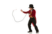 Ring master performing with a whip