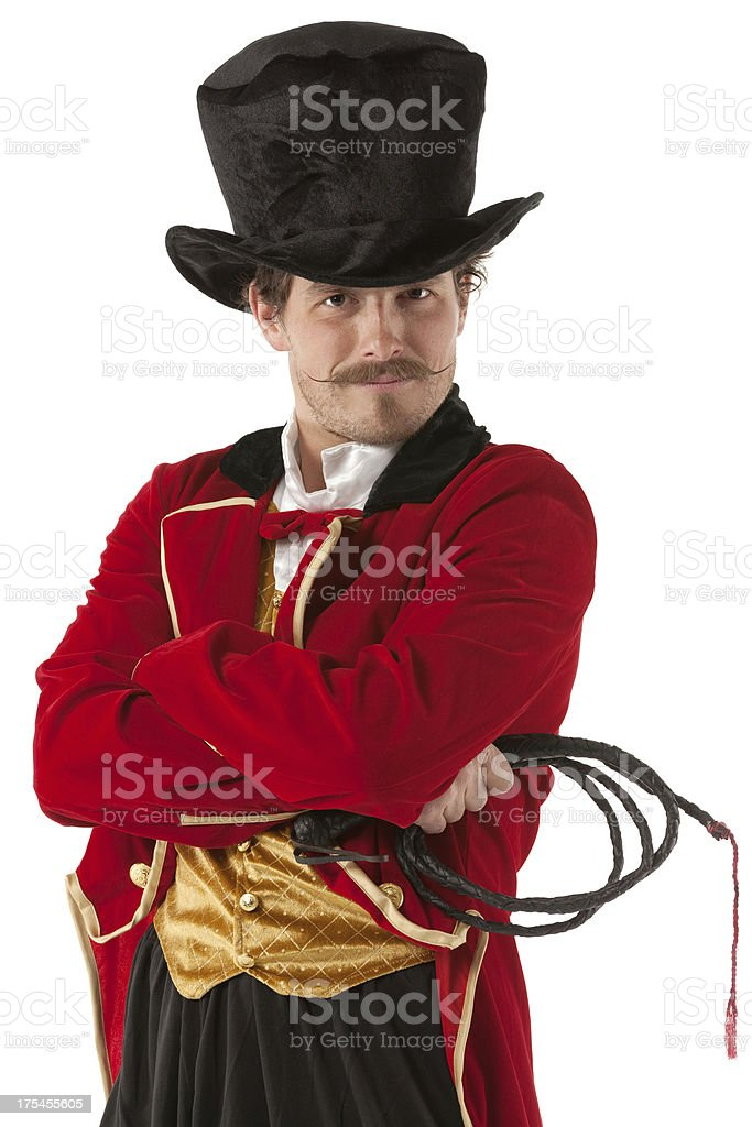 Ring master standing with his arms crossed stock photo