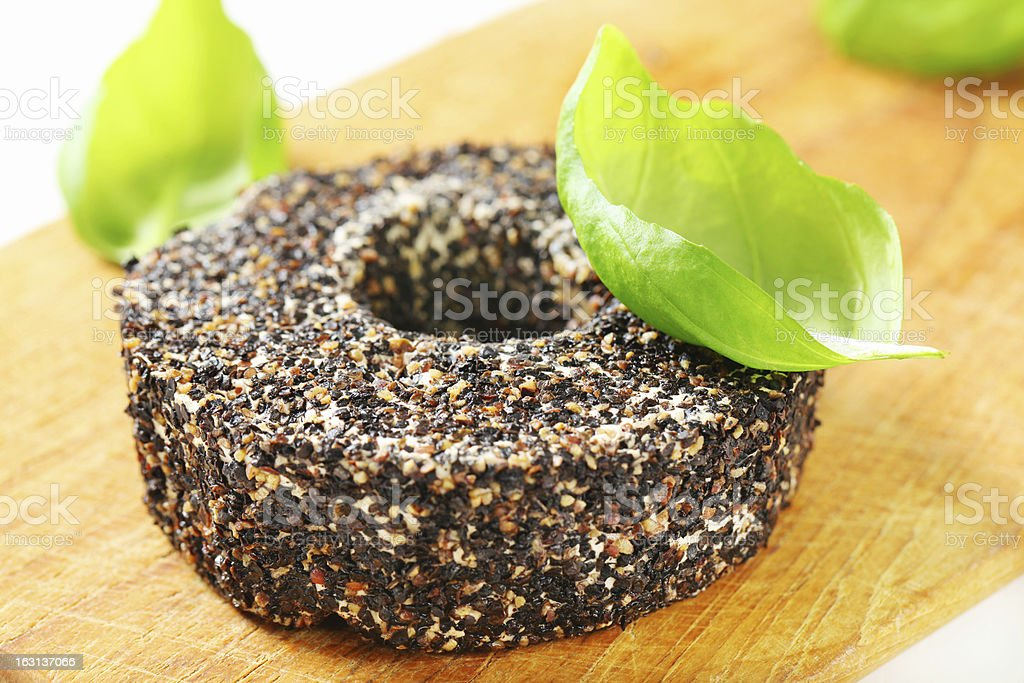 Ring of camambert cheese coated in pepper royalty-free stock photo