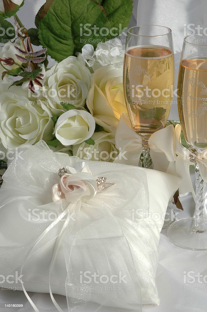 Ring pillow, bouquet and wedding cups royalty-free stock photo