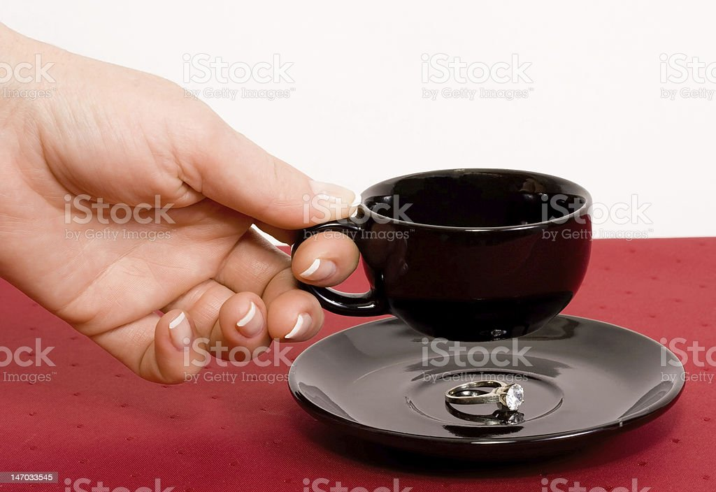 Ring under the cup of coffee royalty-free stock photo