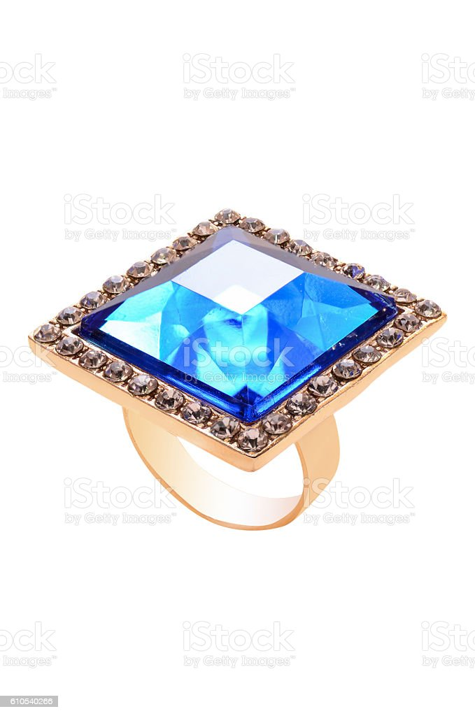 ring with a blue stone on a white background stock photo