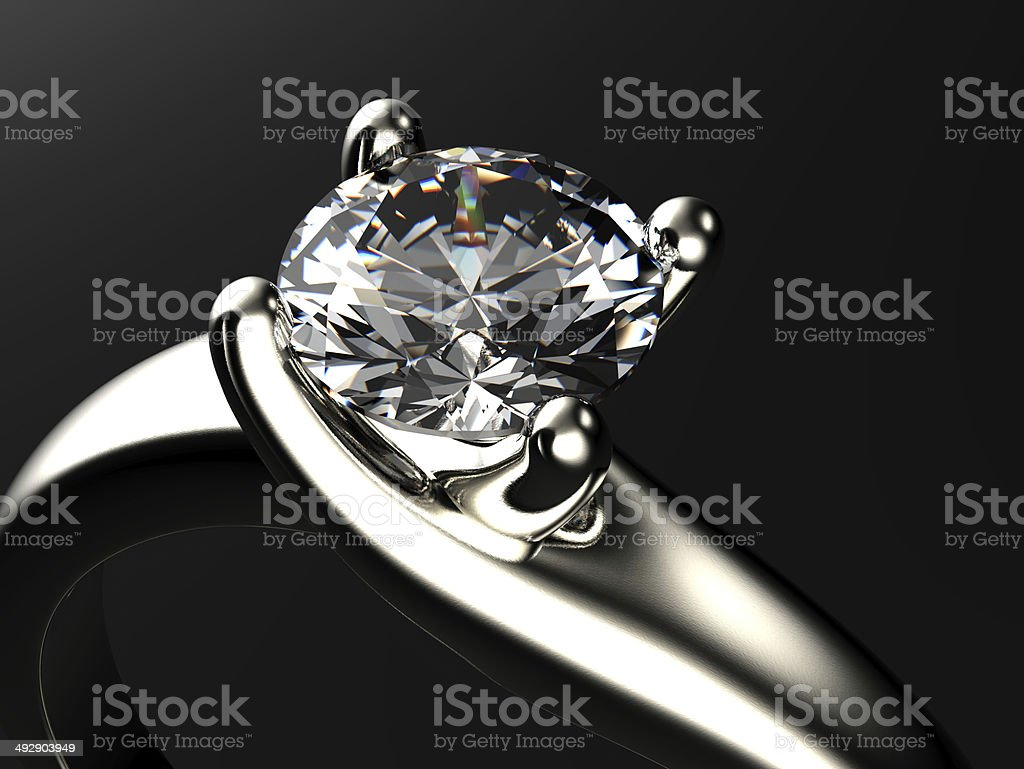 Ring with diamond isolated on gray background stock photo