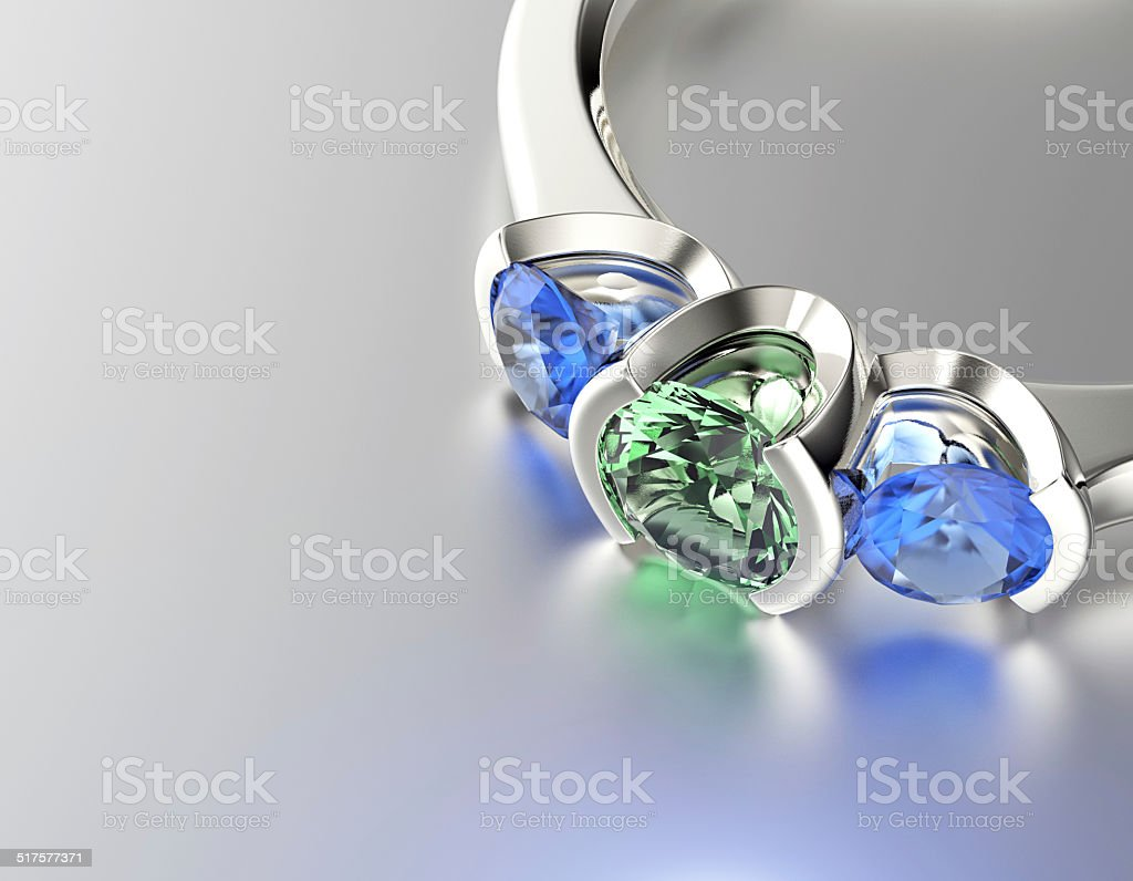 Ring with Emerald. Jewelry background stock photo