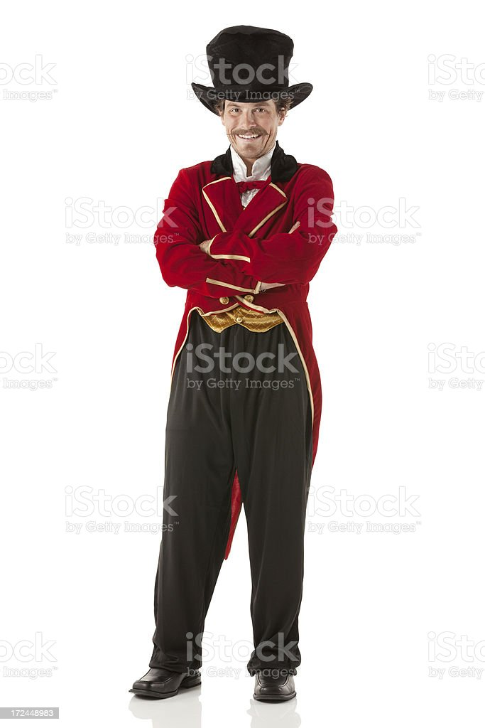 Ringmaster standing with arms crossed stock photo