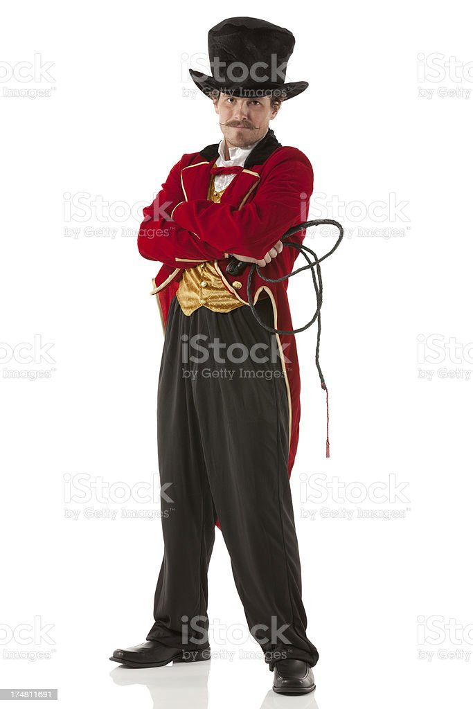 Ringmaster standing with his arms crossed royalty-free stock photo