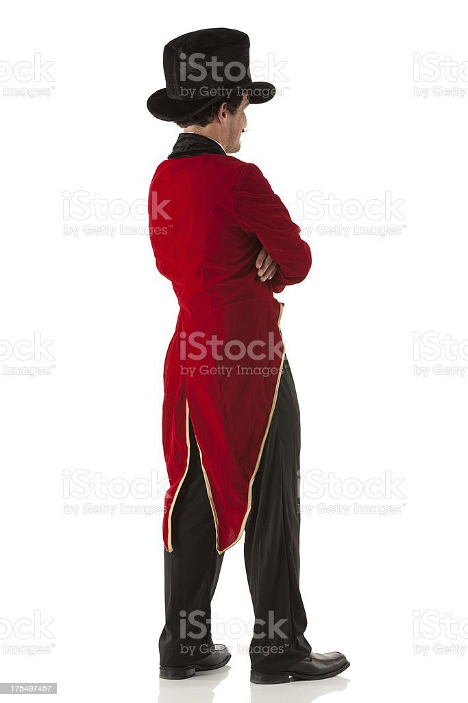 Ringmaster standing with his arms crossed stock photo
