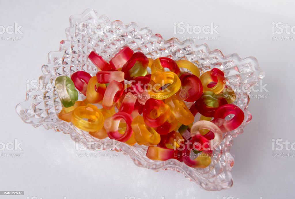 Rings candy sweets in a glass tray. stock photo