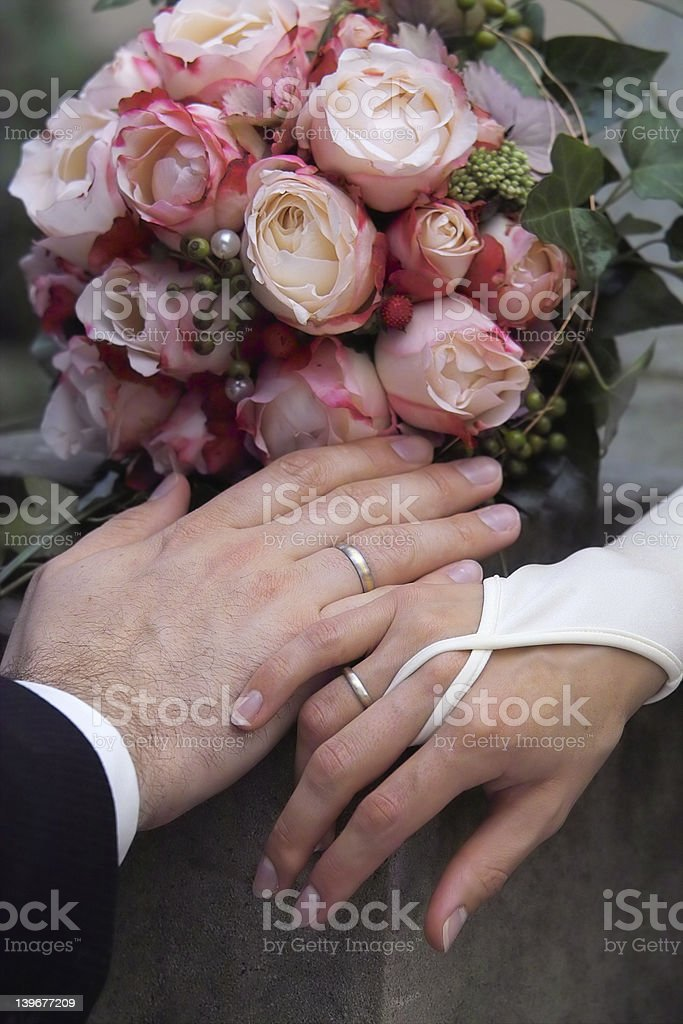 Rings, hands and flowers royalty-free stock photo