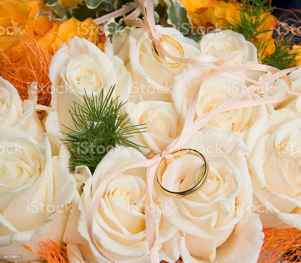 Rings on flowers and white roses. royalty-free stock photo
