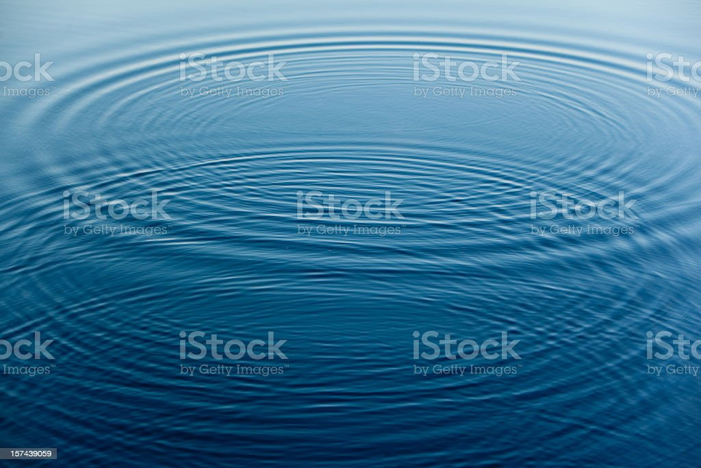 rings on the water surface stock photo