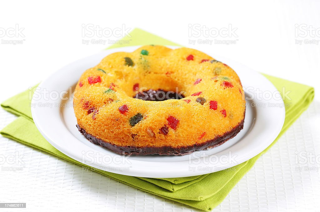 Ring-shaped cake with candied fruit royalty-free stock photo