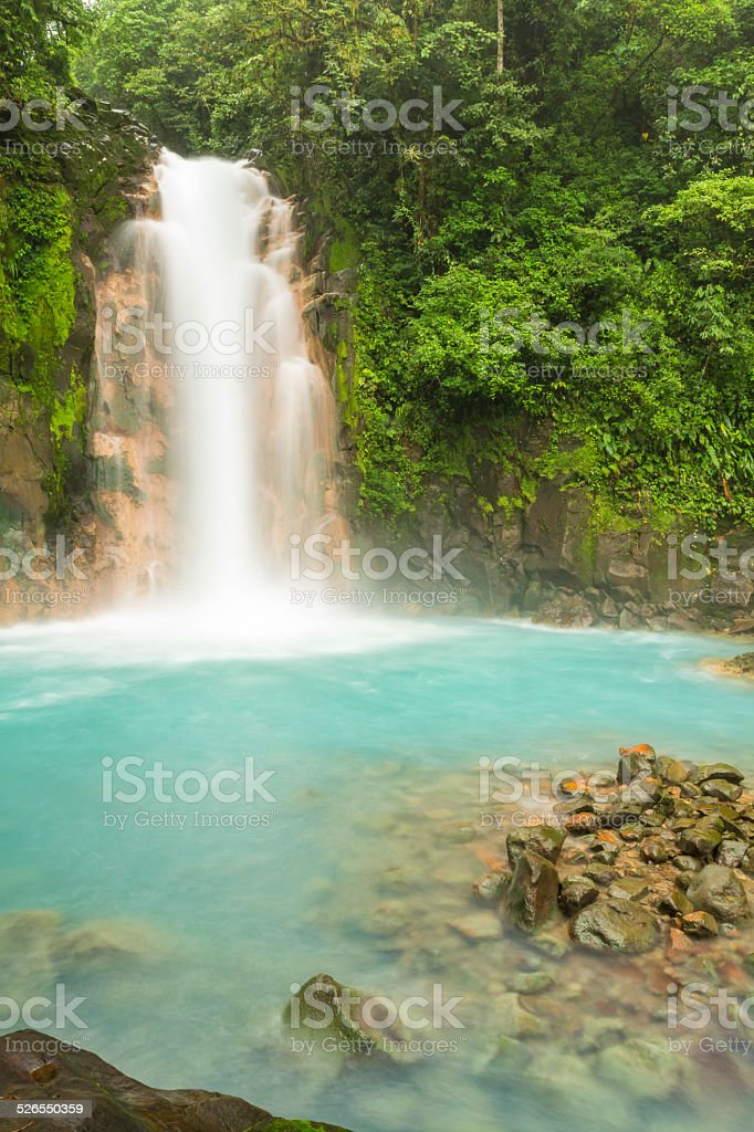 Rio Celeste Waterfall and Sulphurous Rocks stock photo