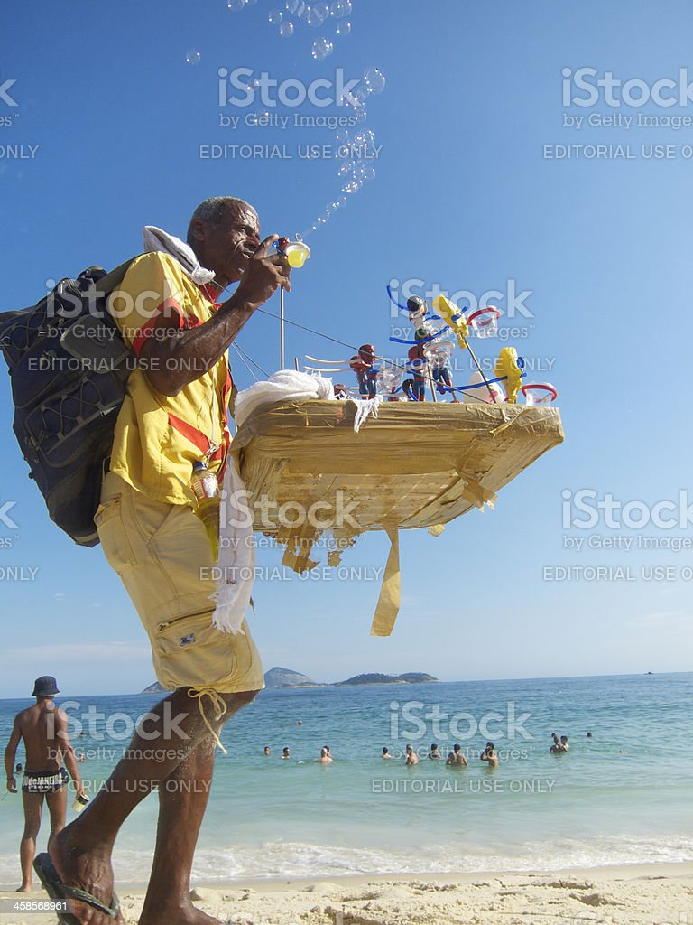 Rio de Janeiro Beach Vendor Blows Bubbles stock photo