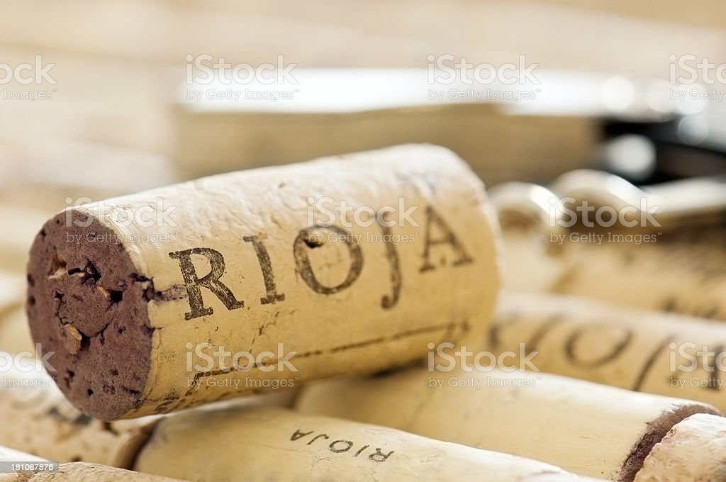 Rioja cork and corkscrew lying on other corks stock photo