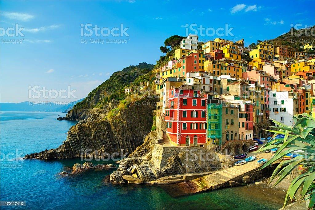 Riomaggiore village, rocks and sea at sunset. Cinque Terre, Ligu stock photo